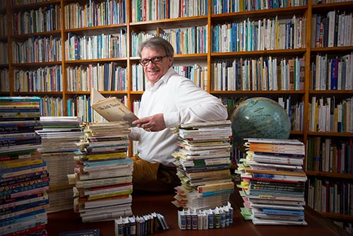 Jean-Marc Probst amid his book collection of the Little Prince in Lausanne, Switzerland